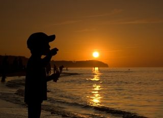 Silhouette Of Child On Sunset Beach